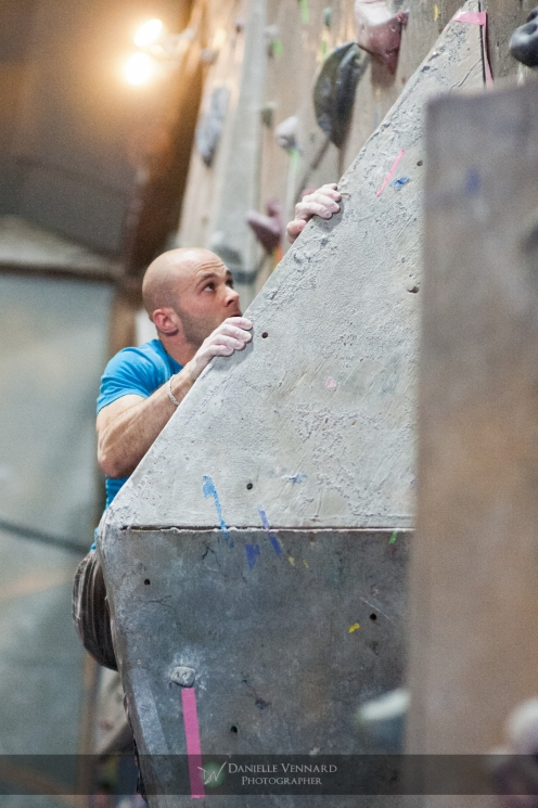 Rocky Woodling on a tough arete problem at the Climbnasium Frostbite Comp 2012