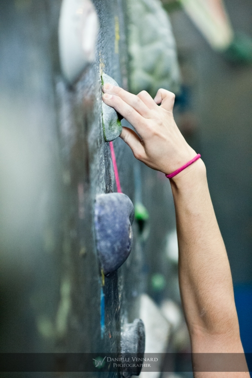 two fingers desparately holding on to this difficult crimp during the Climbnasium Frostbite Climbing Comp 2012