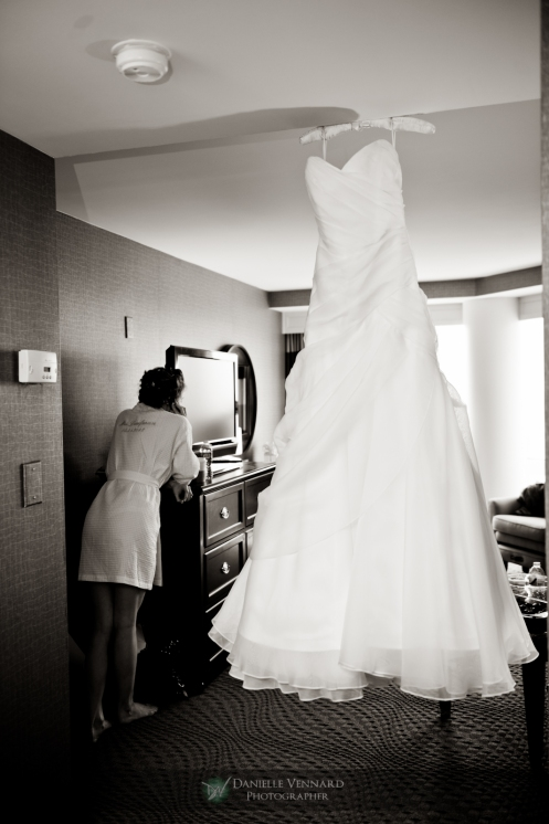 displaying the dress with bride anxious to get ready