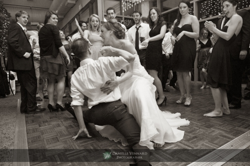 Groomsmen does split while dancing with Bride