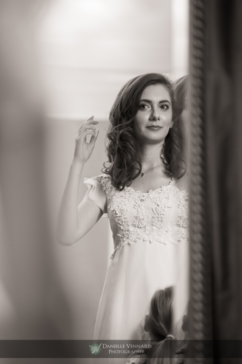 bride checking herself out in the mirror after all final touches were complete Copyright 2012 Danielle Vennard Photographer