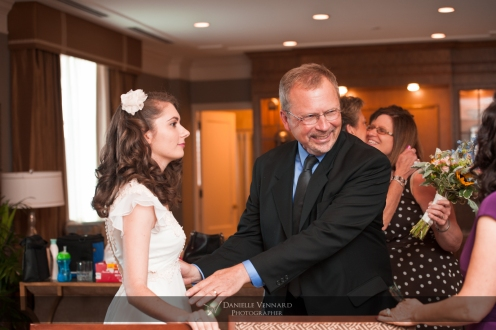 Dad amazed at seeing his daughter in her Mom's wedding dress Copyright 2012 Danielle Vennard Photographer