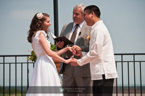 laughter between the bride and groom intiated by the words of the officiant Copyright 2012 Danielle Vennard Photographer