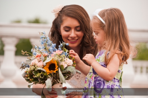 Bride and her niece appreciating the bridal bouquet Copyright 2012 Danielle Vennard Photographer