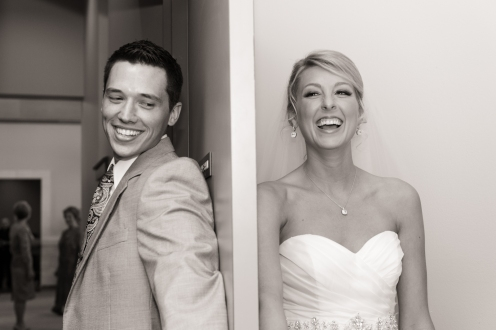 bride and groom have a moment on opposite sides of a door before the ceremony begins