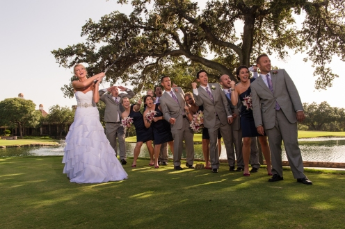 bride pretending to tee off for a bridal party portrait