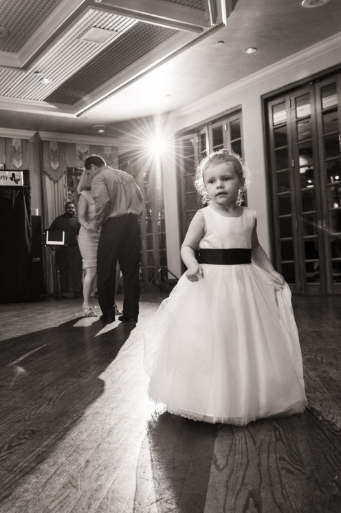 flower girl twirling on the dance floor