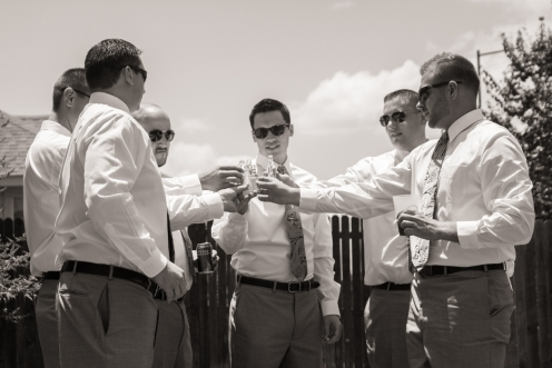 groom and his groomsmen enjoying a tiny beverage before heading to the ceremony