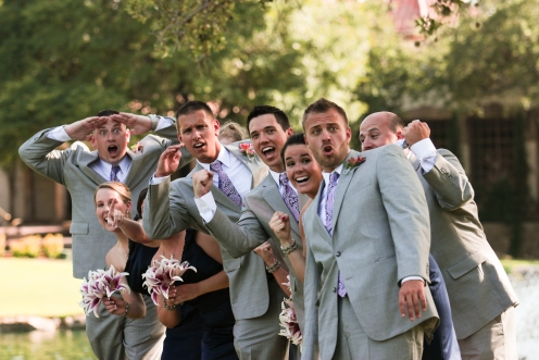 Bridal party and Groom cheer on the bride