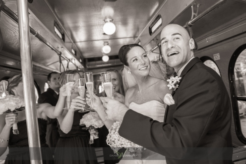 a celebratory toast of champagne on the trolley with bride, groom and bridal party