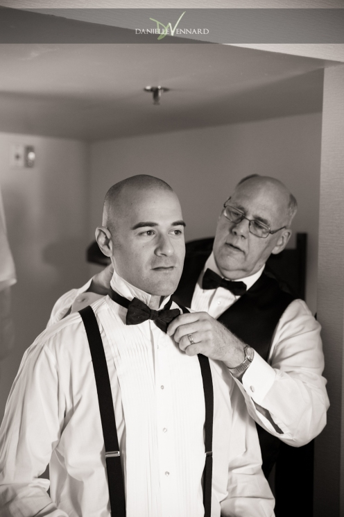 the groom and his dad putting his bowtie on