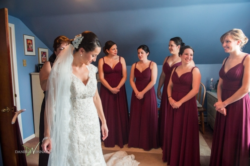 bride with her mom and bridesmaids