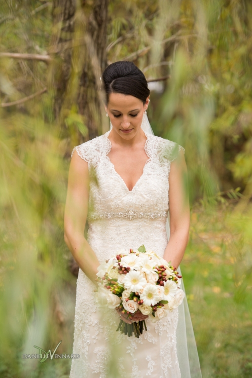 bride in the middle of a weeping willow tree