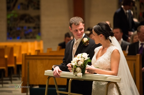 the bride and groom exchanging loving glances during the ceremony