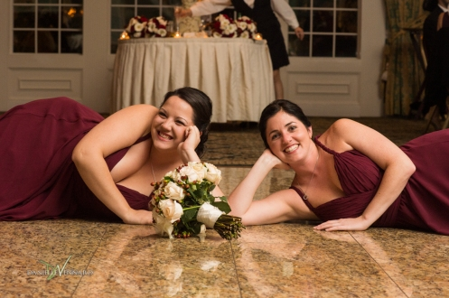 2 bridesmaids and the bride's bouquet