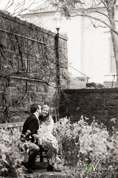 Engaged couple in small garden area behind Moravian Bookstore, Bethlehem, PA