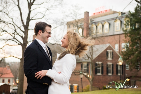 Engagement Photography - Danielle Vennard Photographer - engaged couple in Bethlehem, PA - wind blowing her hair with Hotel Bethlehem sign in background