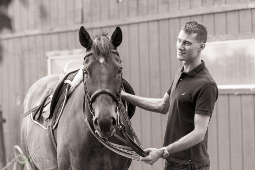 Groom to be settling his bride to be's horse
