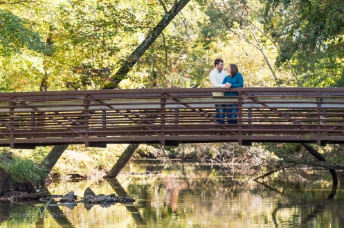 Engaged Couple standing on the bridge at Silver Lake, Dover, DE - Engagement Photography by Danielle Vennard Photographer - In Pursuit of Moments Unreahearsed - daniellevennard.com