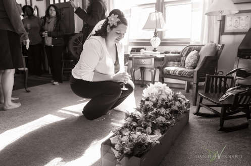 Bride admiring her flowers - Wedding Photography by Danielle Vennard Photographer - In Pursuit of Moments Unrehearsed - daniellevennard.com