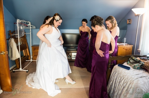 Bride almost finished getting ready with her bridesmaids - Wedding Photography by Danielle Vennard Photographer - In Pursuit of Moments Unrehearsed - daniellevennard.com