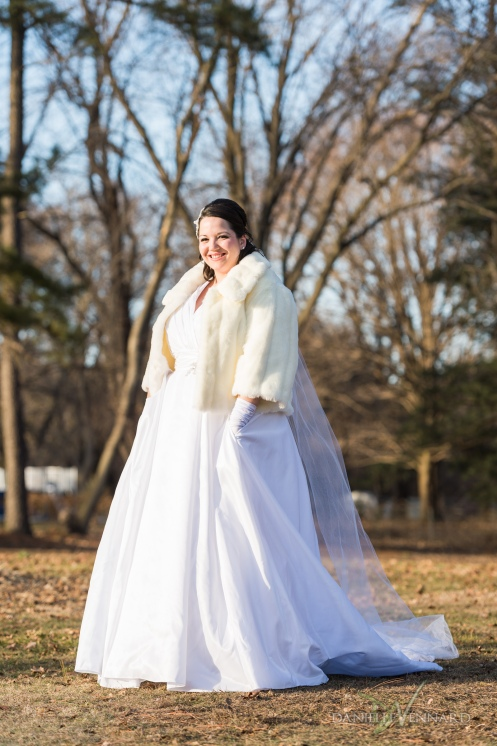 Portrait of the Bride outside in February wearing short fur coat - Wedding Photography by Danielle Vennard Photographer - In Pursuit of Moments Unrehearsed - daniellevennard.com
