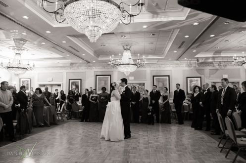 Bride and Groom during first dance with all their guests looking on in ballroom of Hilton Christiana, DE - Wedding Photography by Danielle Vennard Photographer - In Pursuit of Moments Unrehearsed - daniellevennard.com