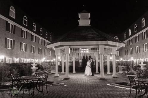 Relaxed portrait of bride and groom under the pavilion in the courtyard of the Hilton Christiana - Wedding Photography by Danielle Vennard Photographer - In Pursuit of Moments Unrehearsed - daniellevennard.com