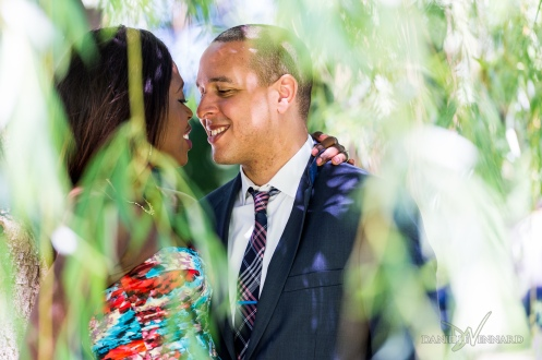 Engaged couple seen through weeping willow trees - Boston Public Gardens - Engagement Photography by Danielle Vennard Photographer - In Pursuit of Moments Unrehearsed - daniellevennard.com