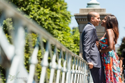 Engaged couple enjoying a moment together on the bridge while people walk by - Boston Public Gardens - Boston, MA - Engagement Photography by Danielle Vennard Photographer - In Pursuit of Moments Unrehearsed - daniellevennard.com
