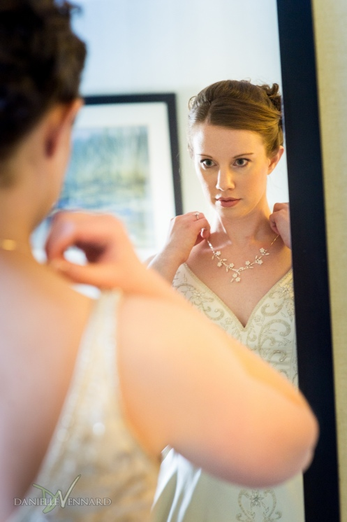 Bride getting her necklace on - Photography by Danielle Vennard Photographer - In Pursuit of Moments Unrehearsed - daniellevennard.com