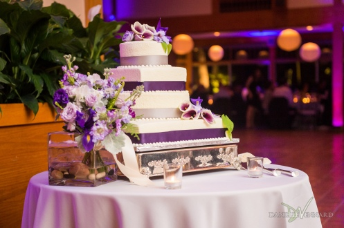 White cake with purple ribbon trim and flowers wedding cake - Photography by Danielle Vennard Photographer - In Pursuit of Moments Unrehearsed - daniellevennard.com